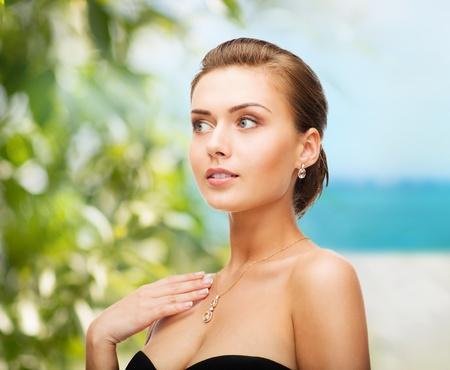beauty and jewelry concept - woman wearing shiny diamond earrings Stock Photo - 21573171