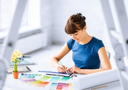 sampler: interior design and renovation concept - woman working with color samples for selection Stock Photo