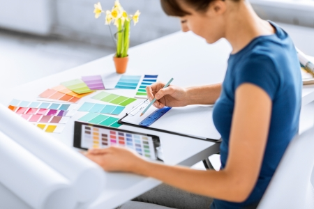 cmyk: interior design, renovation and technology concept - woman working with color samples for selection