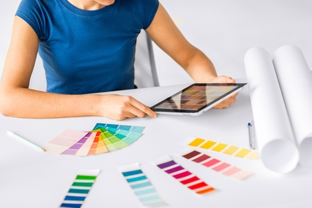interior designer: interior design, renovation and technology concept - woman working with color samples for selection