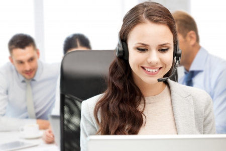 business, technology and call center concept - helpline operator with headphones in call centre