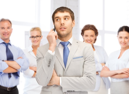 business concept - businessman talking on the phone in office photo