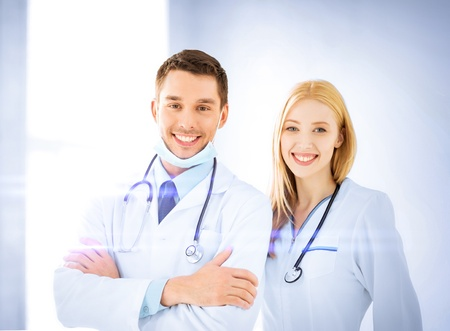 healthcare and medicine concept - two young attractive doctors