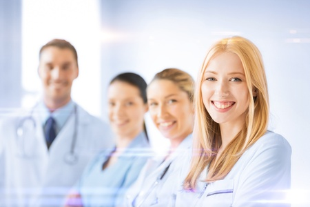 laboratories: healthcare and medicine concept - female doctor in front of medical group