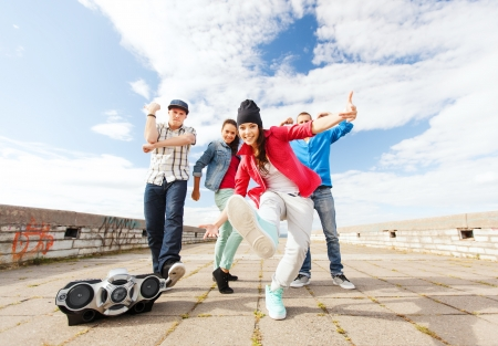 boom box: sport, dancing and urban culture concept - group of teenagers dancing
