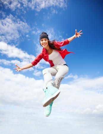 funky music: sport, dancing and urban culture concept - beautiful dancing girl jumping