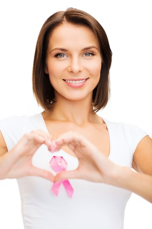 female breast: healthcare, medicine and breast cancer concept - woman with pink cancer ribbon Stock Photo