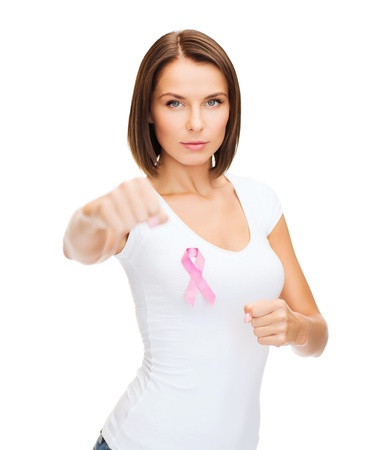 breast cancer: healthcare, medicine and breast cancer concept - woman with pink cancer ribbon Stock Photo
