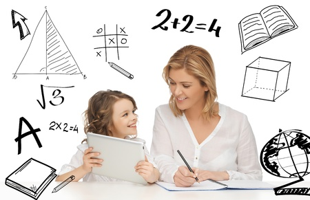 education, technology, internet and parenting concept - girl and mother doing homework with tablet pc photo