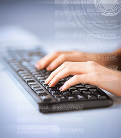 blogs: business, education and technology concept - woman hands typing on keyboard