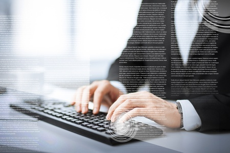 business, education and technology concept - man hands typing on keyboard Imagens