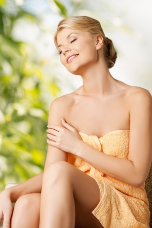 lotions: spa and beauty concept - woman sitting in spa Stock Photo