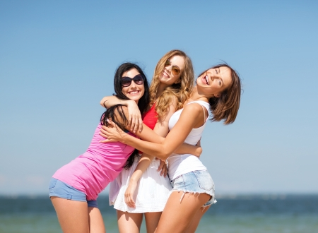 girlfriend: summer holidays and vacation - group of girls having fun on the beach