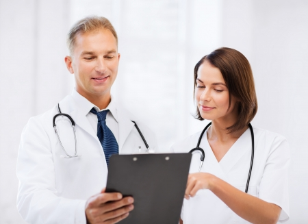 healthcare and medical concept - two doctors discussing diagnosis Stok Fotoğraf