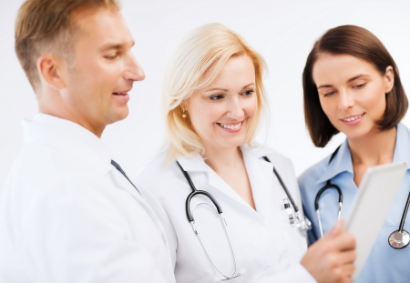 radiology: healthcare and technology concept - doctors looking at tablet pc