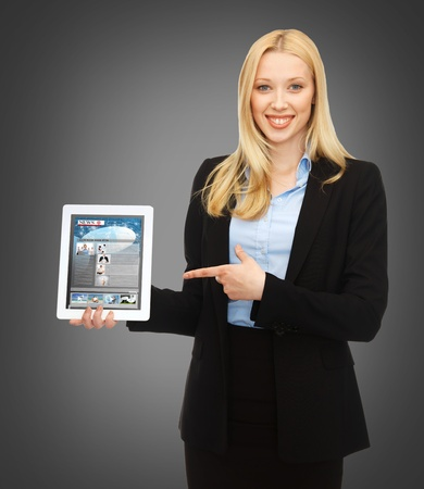 business, technology, internet and news concept - woman showing tablet pc with news app photo