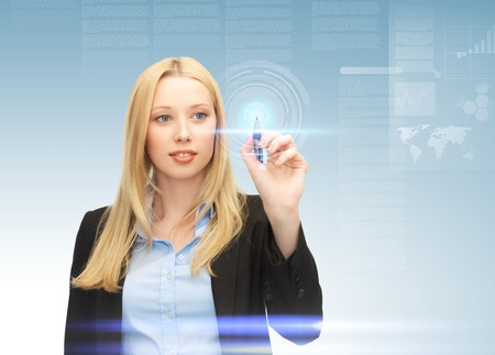 high tech world: future technology and internet - attractive businesswoman working with virtual screen Stock Photo