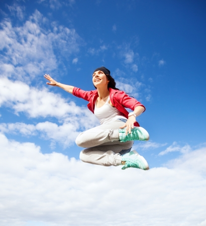 young dancer: sport, dancing and urban culture concept - beautiful dancing girl jumping