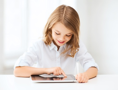 wifi: education, school, technology and internet concept - little student girl with tablet pc at school