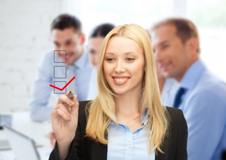 digi: business and technology concept - businesswoman drawing checkmark on virtual screen