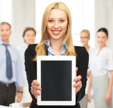 business , education and internet - smiling woman with tablet pc in office photo