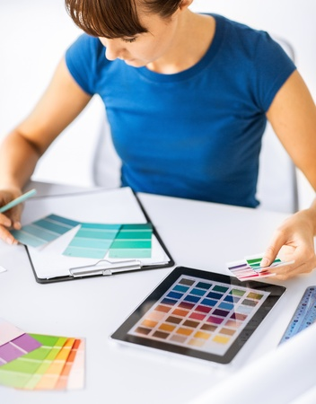 interior design, renovation and technology concept - woman working with color samples for selection photo