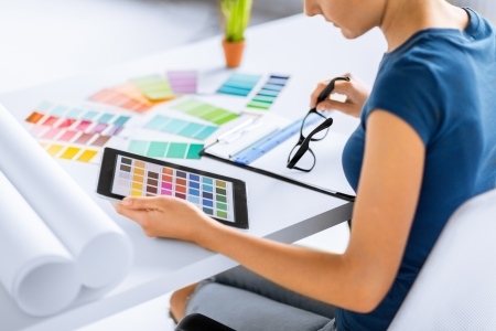designer: interior design, renovation and technology concept - woman working with color samples for selection