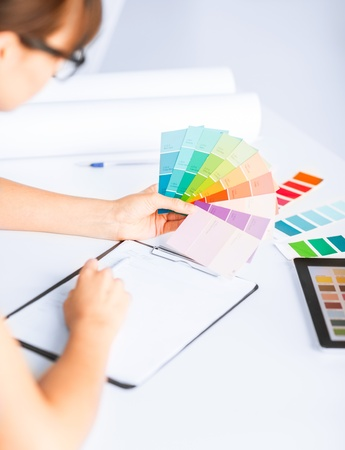 interior design and renovation concept - woman working with color samples for selection photo