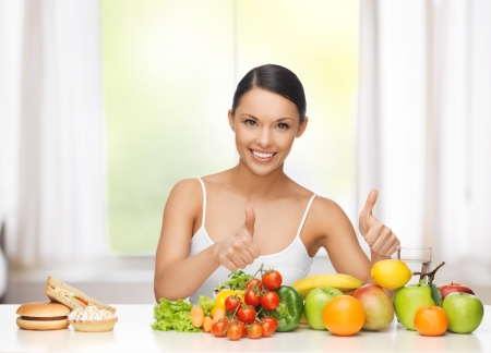 unhealthy lifestyle: healthy and junk food concept - woman with fruits rejecting hamburger and cake