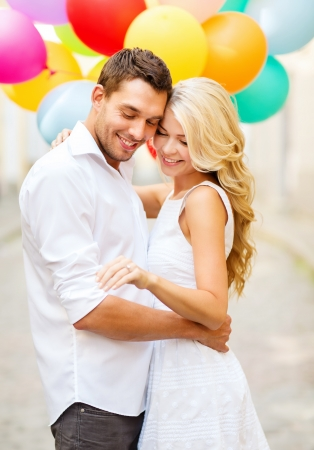 balloon love: summer holidays, celebration and wedding concept - couple with colorful balloons and engagement ring