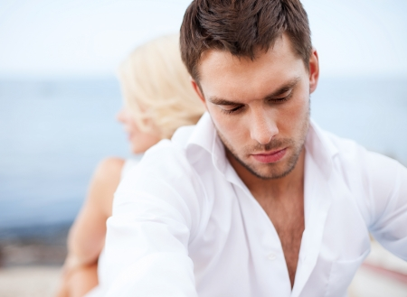 breaking up: dating and relationships concept - stressed man with man outside