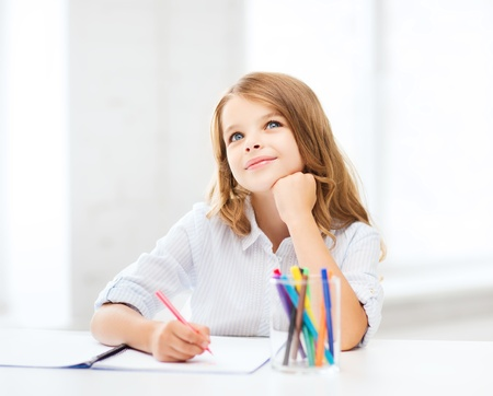 education and school concept - little student girl drawing at school Stock Photo - 21847711