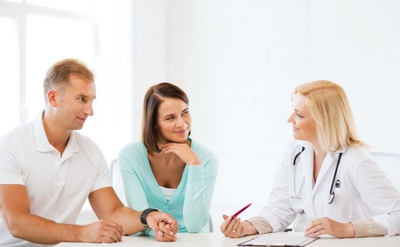 gynecologist: healthcare and medical concept - doctor with patients in cabinet