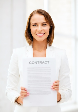 municipal utilities: business and real estate concept - businesswoman holding contract