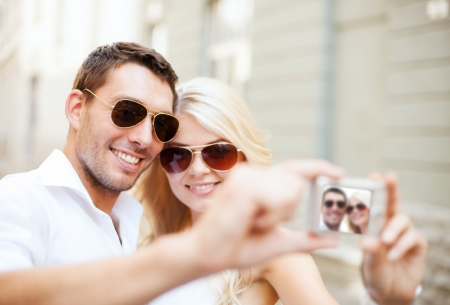 dating and romance: summer holidays and dating concept - couple taking photo in cafe in the city