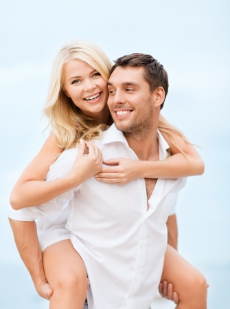 anniversary beach: summer holiday, vacation, dating and tourism concept - happy couple having fun on the beach Stock Photo