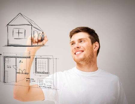 real estate, technology and accomodation concept - man drawing house and blueprint on virtual screen Stock Photo