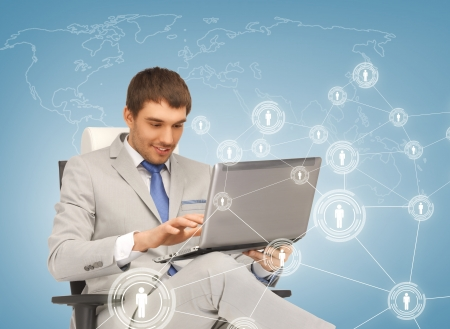 business, technology, internet and networking concept - businessman networking with laptop pc and virtual screens photo