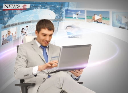 mass media: business, technology, internet and news concept - businessman with laptop pc and virtual screens reading news Stock Photo
