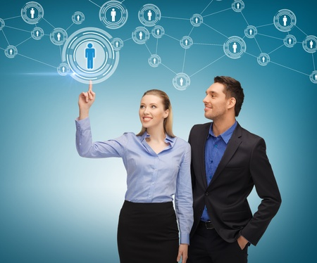 new media: business, technology, internet and networking concept - man and woman working with virtual screen