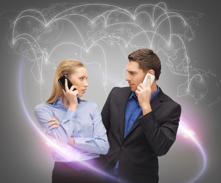business, technology, communication and networking concept - man and woman calling with smartphones and virtual screen photo