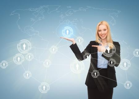 iconos contacto: negocios, tecnolog�a, internet y el concepto de red - empresaria que se�ala en los iconos de contacto en la pantalla virtual Foto de archivo