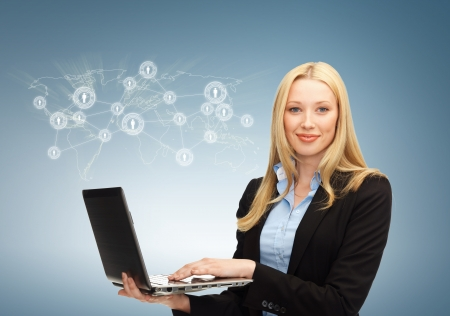 virtual community: business, technology, internet and networking concept - businesswoman with laptop and virtual screen Stock Photo