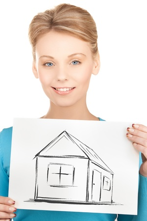 real estate, property, business and accomodation concept - woman holding picture with house photo
