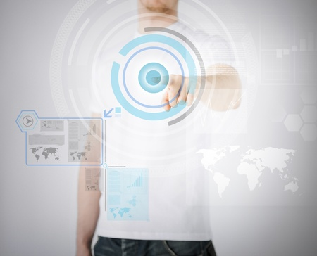 digi: business, technology, internet and networking concept - businessman pressing button with contact on virtual screens