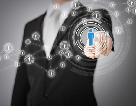 corporate social: business, technology, internet and networking concept - businessman pressing button with contact on virtual screens
