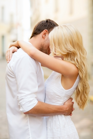 women hugging: summer holidays and dating concept - couple in the city