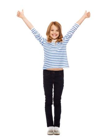 教育・学校・ ジェスチャー コンセプト - 親指に現れるかわいい女の子 写真素材