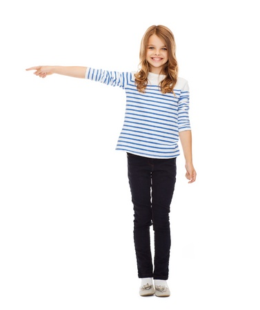girls in jeans: education, school and gesture concept - cute little girl pointing to the side