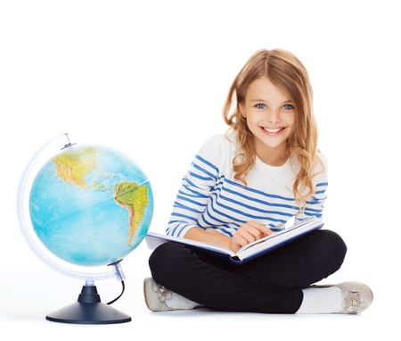 schoolkid search: education and school concept - little student girl studying geography with globe and book